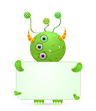 Green smily monster with empty placard Stock Image