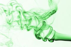 Green smoke. Color composition smoke photo over white Stock Image