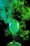 Green smoke in the glass. Halloween. Royalty Free Stock Photos