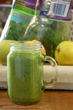 Green smoothie. Green nutritious smoothie with raw veggies and fruits Royalty Free Stock Photos