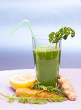 Green Smoothie. With carrot, lemon, parsley and ginger Royalty Free Stock Images
