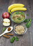 Green smoothie with apples, spinach, banana, germinated buckwheat and cinnamon. Clean eating, fully raw food stock image