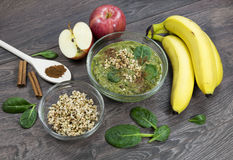 Green smoothie with apples, spinach, banana, germinated buckwheat and cinnamon. Clean eating, fully raw food royalty free stock photos