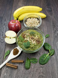 Green smoothie with apples, spinach, banana, germinated buckwheat and cinnamon. Clean eating, fully raw food royalty free stock photography