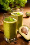 Green smoothie with avocado, kiwi, cucumber and mint Royalty Free Stock Photos