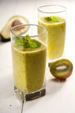 Green smoothie with avocado, kiwi, cucumber and mint Stock Photography
