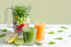 Green smoothie with blender and fruits health diet lifestyle Royalty Free Stock Photos