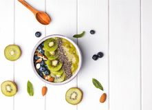 Green smoothie bowl with kiwi, blueberry and chia seeds royalty free stock photography