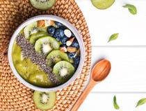 Green smoothie bowl with kiwi, blueberry and chia seeds royalty free stock photos