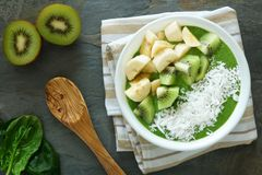 Green smoothie bowl with spinach, kiwi, bananas and coconut Stock Images