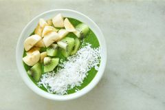 Green smoothie bowl on a white marble background Stock Image