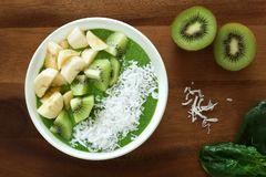 Green smoothie bowl on a wood background Stock Photo