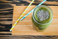 Green smoothie with chia seeds in a heart shape. royalty free stock photos