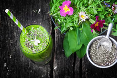 Green Smoothie with Chia seeds. And wild herb salad stock images