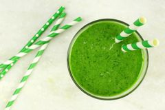 Green smoothie downward view on granite Royalty Free Stock Photography