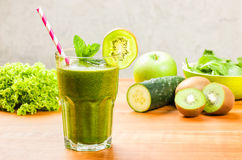 Green Smoothie with a drinking straw Royalty Free Stock Photo