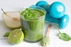 Green smoothie and dumbbells health diet lifestyle Royalty Free Stock Photography