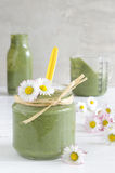 Green smoothie with edible wild herbs in a glass bottle with straws Stock Photos