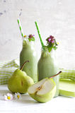 Green smoothie with edible wild herbs and pears Royalty Free Stock Photography