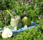 Green smoothie with edible wild herbs and pears Stock Photography