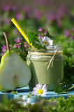 Green smoothie with edible wild herbs and pears Stock Images