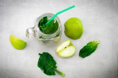Green smoothie in glass jar with fresh organic green vegetables Royalty Free Stock Image