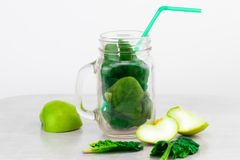 Green smoothie in glass jar with fresh organic green vegetables Stock Photo