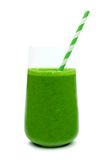 Green smoothie in a glass with paper straw  Royalty Free Stock Images