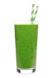 Green smoothie in glass with straws isolated on white Royalty Free Stock Photography