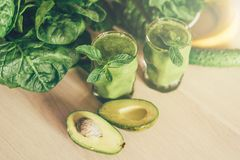 Green smoothie in glasses stock photography