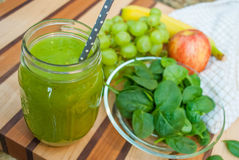 Green Smoothie with Healthy Fruit and Vegetable Ingredients. Green Smoothie Blended with Healthy Fruit and Vegetable Ingredients Royalty Free Stock Image