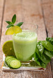 Green smoothie. Healthy green smoothie on wood background Stock Photos