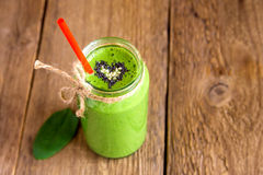 Green smoothie with heart of seeds Royalty Free Stock Image
