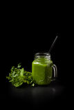 Green smoothie and herbs royalty free stock photos