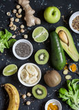 Green smoothie ingredients. Cooking healthy detox smoothies. On a dark background Royalty Free Stock Images