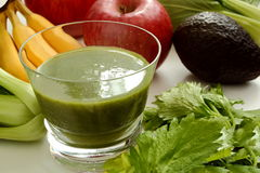 Green smoothie and ingredients Stock Image