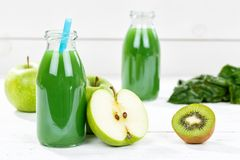 Green smoothie juice apple kiwi spinach fruit fruits royalty free stock photography
