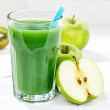 Green smoothie juice apple kiwi spinach square glass fruit fruit stock photos