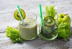 Green smoothie with kiwi, apple, salad and broccoli, healthy dri Stock Image