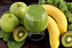 Green smoothie. Made with spinach, kale, kiwi, green apples and bananas Stock Image