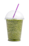 Green smoothie in plastic cup Stock Image