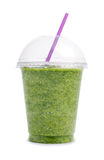 Green smoothie in plastic cup Royalty Free Stock Photos