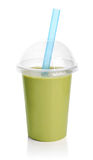 Green smoothie in plastic transparent cup. Isolated on white background. Take away drinks concept royalty free stock photography