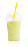 Green smoothie in plastic transparent cup Royalty Free Stock Images