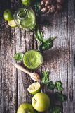 Green Smoothie with Spinach, Apple, Lime and Ginger for an Healthy Drink. On wooden Background royalty free stock image