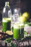 Green Smoothie with Spinach, Apple, Lime and Ginger for an Healthy Drink. On wooden Background royalty free stock photos