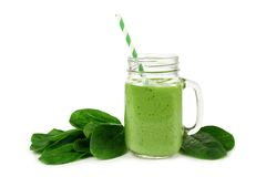 Green smoothie with spinach isolated. Healthy green smoothie with spinach in a jar mug isolated on white Royalty Free Stock Images