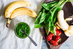 Green smoothie with spinach, kiwi, banana and mint, detox drink Stock Photos