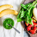 Green smoothie with spinach, kiwi, banana and mint, detox drink Stock Photo