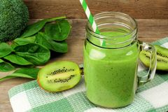 Green smoothie with spinach and kiwi royalty free stock photo